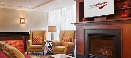 Lobby and fireplace at Hotel Carlingview Toronto Airport
